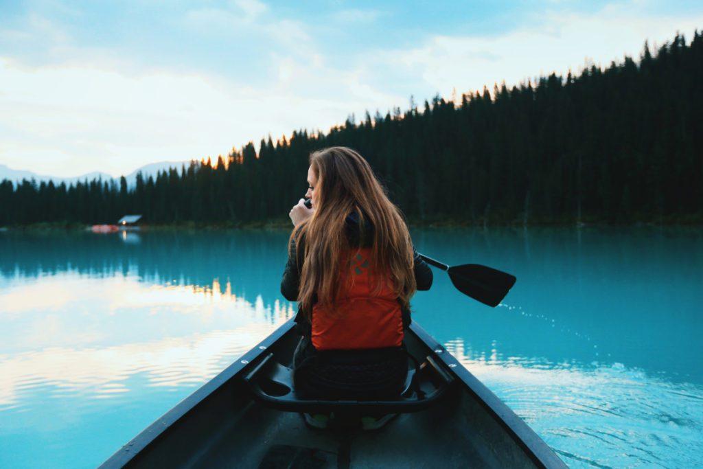 solo traveller in a canoe