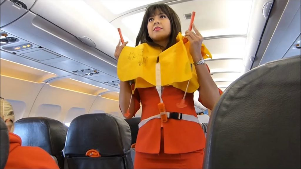 listen to the flight attendant's safety instructions